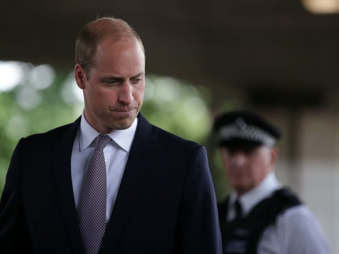 Prince William hugged a victim of the fire — it was a sweet gesture of comfort that also broke royal protocol Photo (C) GETTY IMAGES