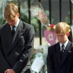 Prince William pictured left and Prince Harry are seen bowing their heads as their mothers coffin is taken out of Westminster Abbey following her funeral service in September 1997