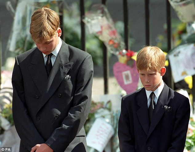 Prince William, pictured left, and Prince Harry are seen bowing their heads as their mother's coffin is taken out of Westminster Abbey following her funeral service in September 1997