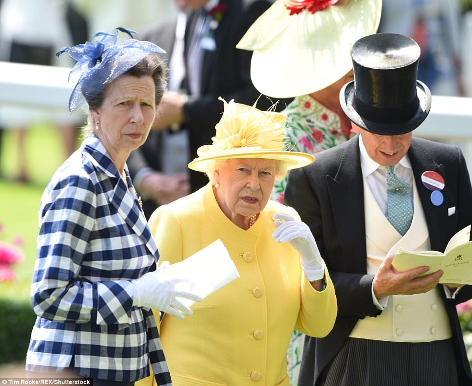 Princess Anne also joined her mother, wearing a striking blue and white checked jacket and gloves