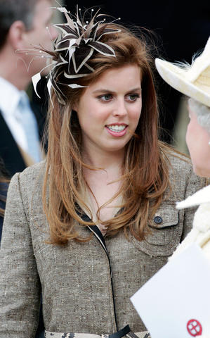 09 Apr 2005, Windsor, Berkshire, United Kingdom UK --- Princess Beatrice talking to her grandmother, Queen Elizabeth II outside St George's Chapel in Windsor Castle after the Service of Prayer and Dedication, blessing the marriage of The Prince of Wales, Prince Charles, and the Duchess of Cornwall, Camilla Parker-Bowles. --- Image by © Tim Graham/Corbis