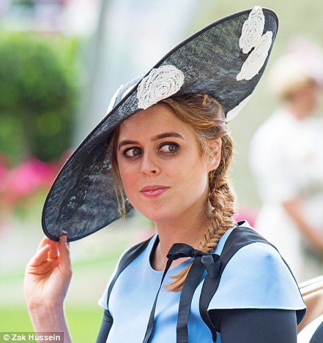Princess Beatrice usually wears her auburn locks flowing around her shoulders, but today she opted for a fishtail braid