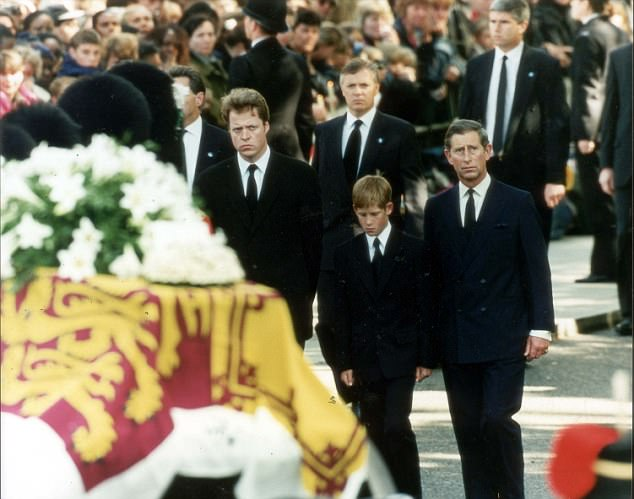 ROYALTY PRINCE CHARLES LIFETIME OF PICTURES BY PA  6.9.97  The coffin of Diana, Princess of Wales, makes its way to Westminster Abbey, surrounded by the bearer party of Welsh Guardsmen, followed by (l/r) Earl Spencer, Prince Harry and the Prince of Wales.
