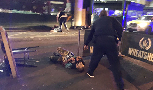 Reported suspect shot at the scene with canisters attached after terror attack Photo (C) GETTY