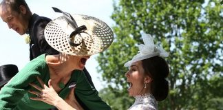 Sophie and Kate laugh uproariously as the Countess loses her balance and stumbles forward before being caught by Kate