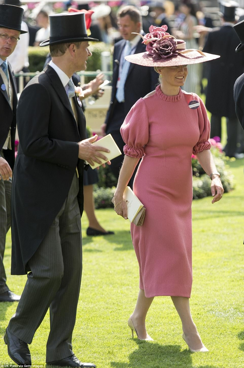 Sophie paired her delicate, rose-coloured, high-necked midi dress with tan heels and simple gold accessories