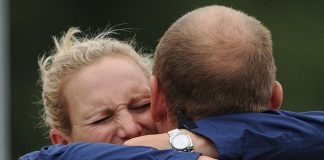 Team Zara Phillips gets a hug from Mike Tindall after the show jumping stage Photo C GETTY IMAGES