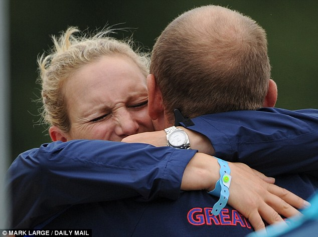 Team Zara Phillips gets a hug from Mike Tindall after the show-jumping stage Photo (C) GETTY IMAGES
