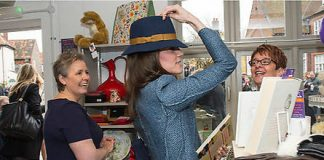 The Duchess of Cambridge knows you should always try before you buy. Prince William's wife popped on a Boden hat, while touring a new EACH charity shop in 2016. Photo: Arthur Edwards - WPA Pool/Getty Images