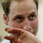 The heat is clearly getting to Prince William as sweat pours from his brow during his tour of Queensland Photo C GETTY IMAGES