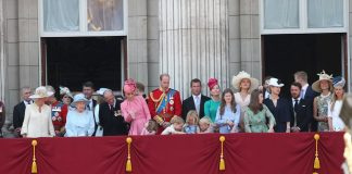 The young Royals towards the centre of the balcony seem to preoccupied with something on the floor as their family gathered on the balcony 1