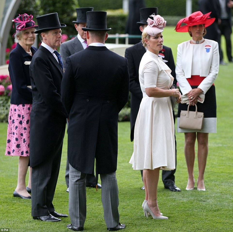 Zara Tindall kept it summery in a white dress nipped in at the waist and a bespoke rose pink cocktail hat by London milliner Juliette Botterill