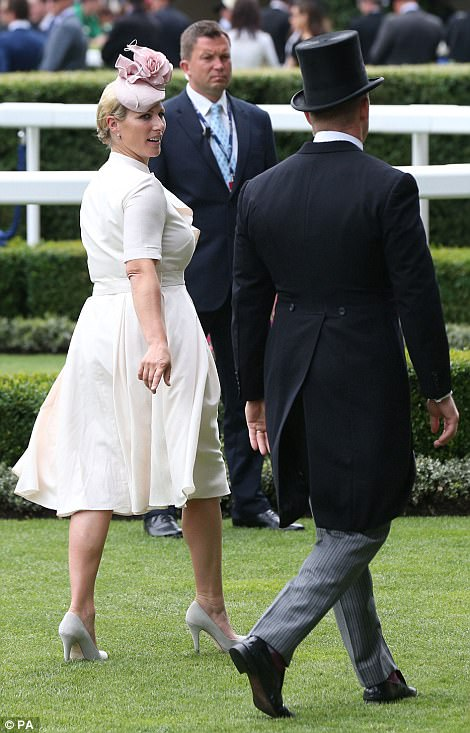 Zara Tindall strides out of the Parade Ring with her husband Mike