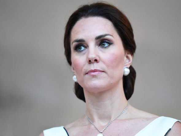 Kate's white sleeveless number was designed by Gosia Baczynska Photo (C) EPA