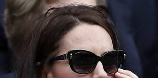 1 As the afternoon sun made an appearance Kate shielded her eyes from the glare with a pair of dark glasses