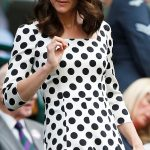 1 Kate adjusts her newly trimmed hairdo as she takes her seat in the Royal Box to watch Andy Murrays first match of the tournament