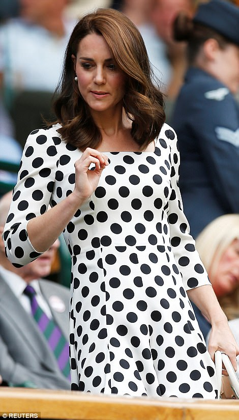 Kate adjusts her newly trimmed hairdo as she takes her seat in the Royal Box to watch Andy Murray's first match of the tournament