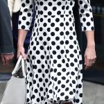 1 Kate eschewed her customary nude court shoes in favour of trendy black ankle strap sandals left. Her usual clutch bag was also left at home with the royal opting for a white tote instead