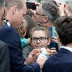 A gift for George and Charlotte Prince William is handed a toy dog by a wellwisher
