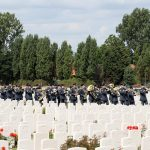 A military band processes through the cemetery this morning ahead of a ceremony attended by European royalty