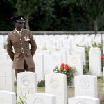 A serviceman at the Commonwealth War Graves Commisionss Tyne Cot Cemetery ahead of a ceremony attended by the Prince Charles