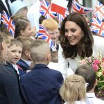 All smiles Kate looked in great spirits as she mingled with local schoolchildren outside Warsaws presidential palace