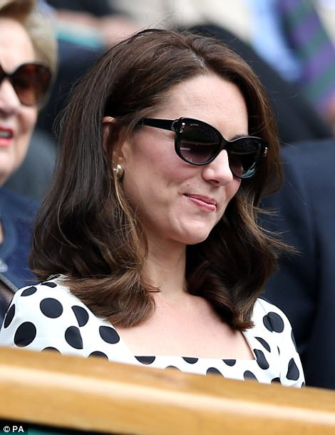 As the afternoon sun made an appearance, Kate shielded her eyes from the glare with a pair of dark glasses