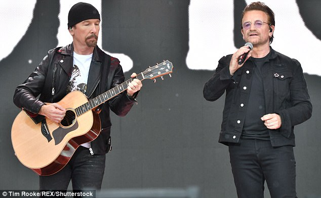 Bono performs in front of cheering crowds on Canada Day in Ottawa with The Edge from U2