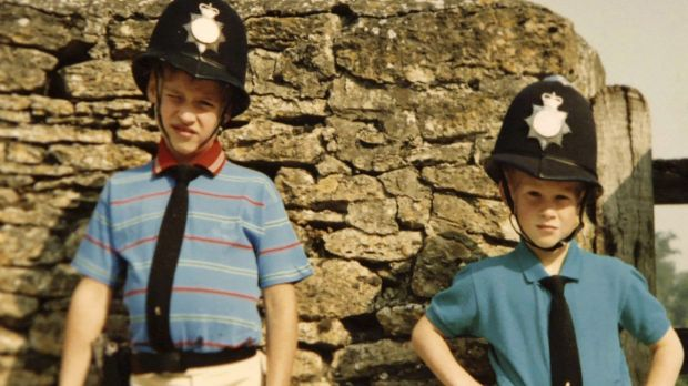 Britain's Prince William, left, and Prince Harry wear policemen outfits in a photo featured in the new ITV Photo The Duke of Cambridge and Prince Harry