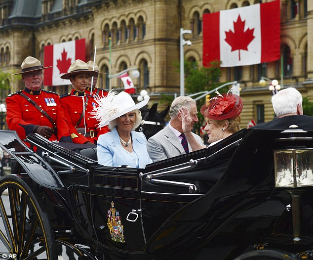 Camilla, Prince Charles, Sharon Johnston and Governor General David Johnston ride in a carriage during Canada 150 celebrations in Ottawa