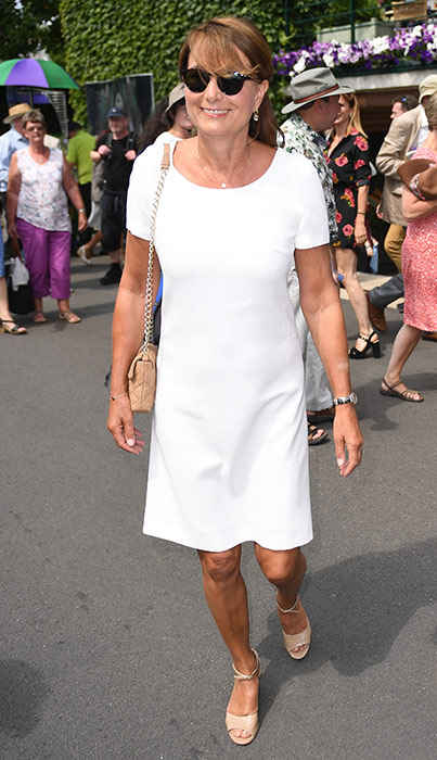 Carole Middleton The Duchess of Cambridge's mother looked lovely in a white dress Photo (C) GETTY IMAGES
