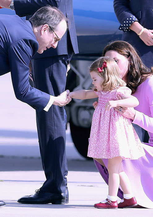 Charlotte gave another royal handshake before returning home Photo C GETTY IMGES
