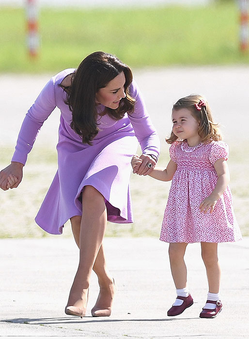 Charlotte looked cute in a pretty pink floral dress, which was teamed with her red leather shoes. Photo (C) GETTY IMAGES