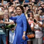 Crowds waves and take photos as Kate makes her way to the Brandenburg Gate accompanied by Private Secretary Rebecca Deacon