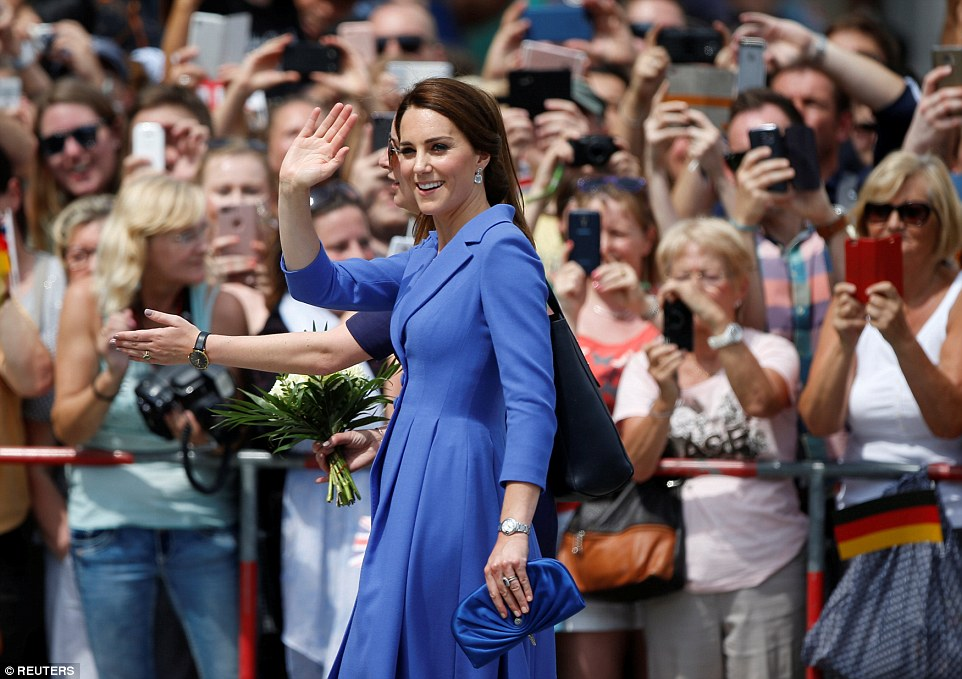 Crowds waves and take photos as Kate makes her way to the Brandenburg Gate, accompanied by Private Secretary Rebecca Deacon