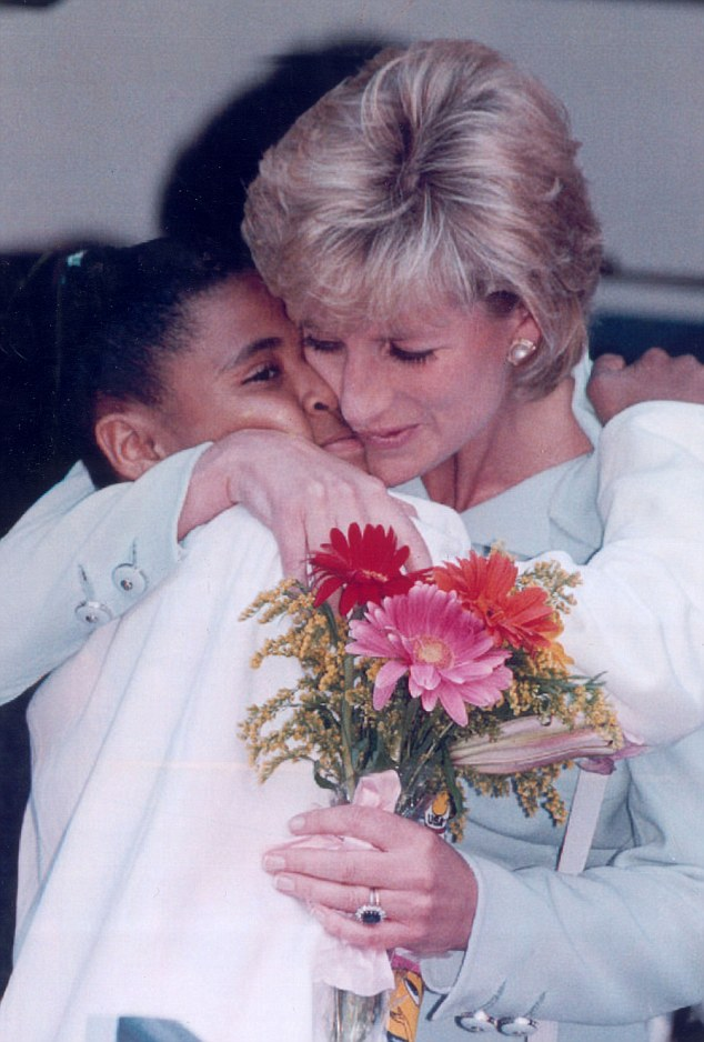 Diana getting a hug from a young girl at the Cook County Hospital in Chicago in 1996, a year before her death in a car crash in Paris