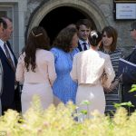 Eugenie pictured in a monochrome dress outside the register office