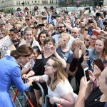 Fans were eager to shake hands with the Duchess and one had even brought along his own sign adorned with an engagement picture of William and Kate