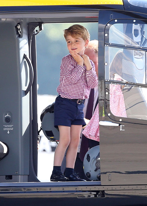 George - who turns four on Saturday - looked rather ecstatic as he boarded a helicopter. Photo (C) GETTY