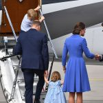 Get a move on Princess Charlotte was eager to get going and board the plane as her mother paused to shake hands