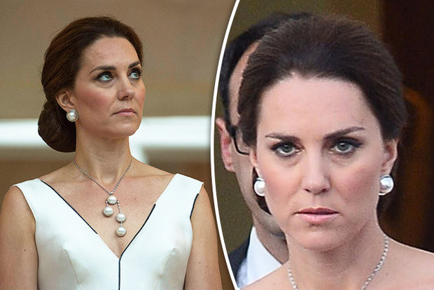 Kate Middleton did not look happy in Poland yesterday Photo C PA SPLASH