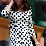 Kate adjusts her newly trimmed hairdo as she takes her seat in the Royal Box to watch Andy Murrays first match of the tournament