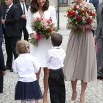 Kate and First Lady Agata Kornhauser Duda were presented with bouquets by two young wellwishers outside the presidential palace in Warsaw