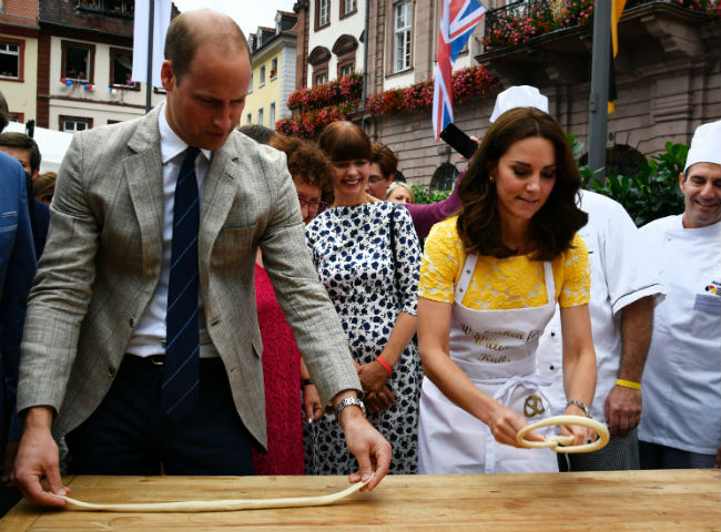 Kate and William had fun making pretzels in Heidelberg Photo (C) GETTY IMAGES