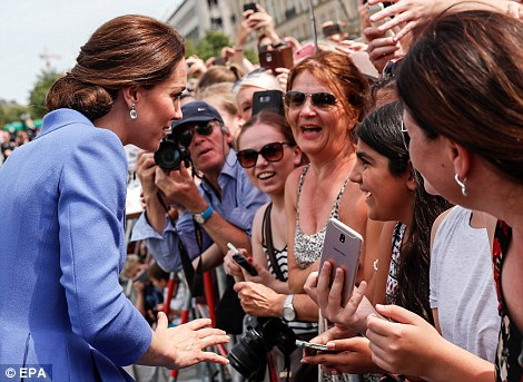 Kate chats to members of the public who had come out in force to greet the royals