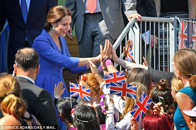 Kate doled out high fives to enthusiastic children who presented her with floral crowns