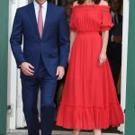 Kate opted for a gypsy style off the shoulder red gown at the garden party tonight a far cry from the plunging neckline she was sporting earlier in the week