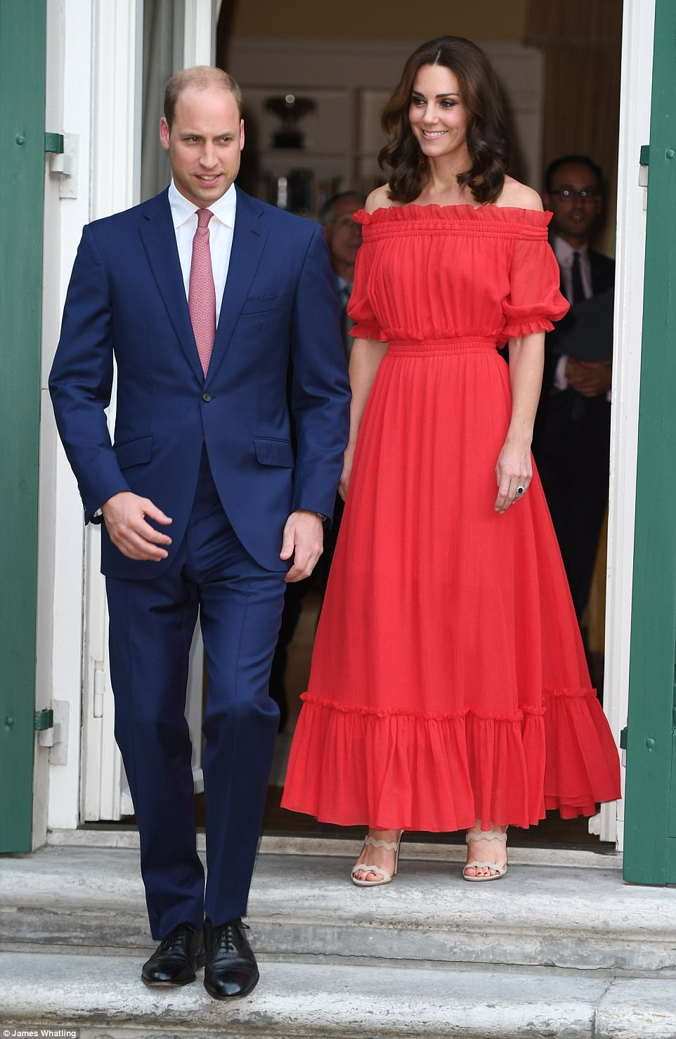 Kate opted for a gypsy-style off-the-shoulder red gown at the garden party tonight - a far cry from the plunging neckline she was sporting earlier in the week