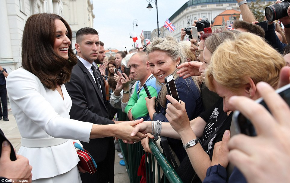 The royal waves to crowds who lined the streets to greet the royal visitors