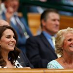Kate takes in the action with Gill Brook wife of the All England Club chairman Philip